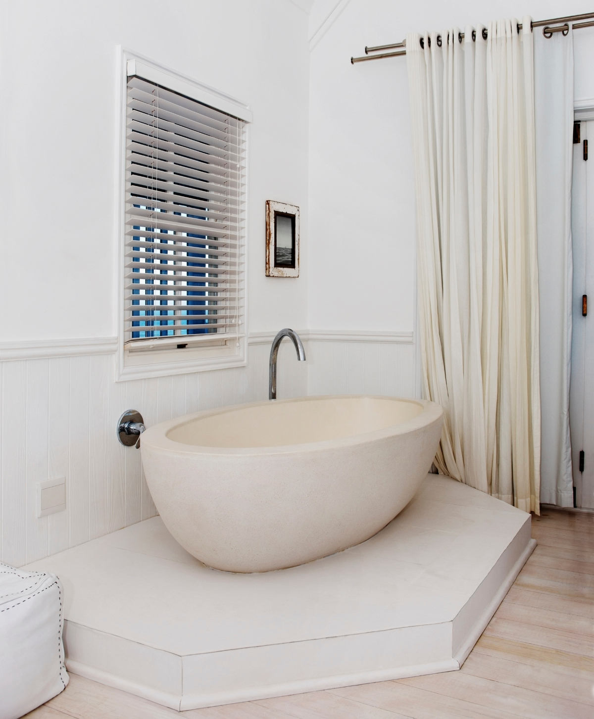 Beautiful white bathtub in the corner of a room